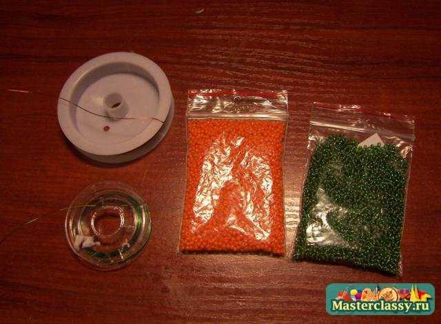 Для изготовления такой рябины Вам понадобиться: бисер оранжевого и зеленого цвета, проволока медного и зеленого цвета...