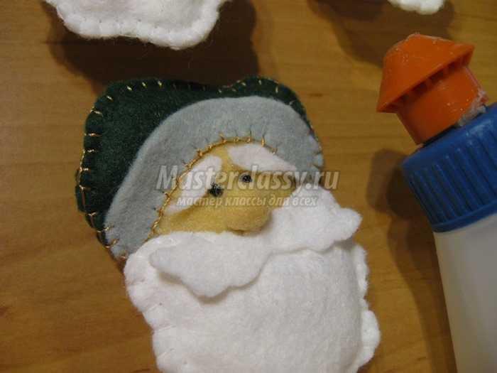 Веселые Санта Клаусы из фетра