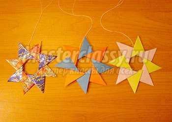 Звездочка из бумаги. Игрушка на елку. Мастер-класс с фото